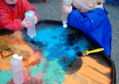 Fun mixing colours at Lilliput Nursery School