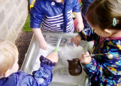 Playtime with water at Lilliput Nursery School